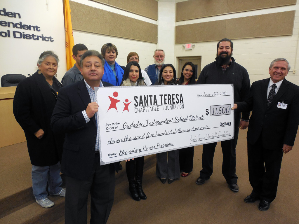 STCF Board Members: Jerry Pacheco, Joshua Orozco, Adriana Castillo, Jessica Hererra, and Priscila Gurrola present a check to GISD Board of Directors