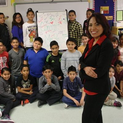Mrs. Guillermo-Rios poses with her Desert Trail Elementary School students in Chaparral. Guillermo-Rios was recently named Bilingual Teacher of the Year by the National Association for Bilingual Education. (Photo: Luis Carlos Lopez / El Paso Times)
